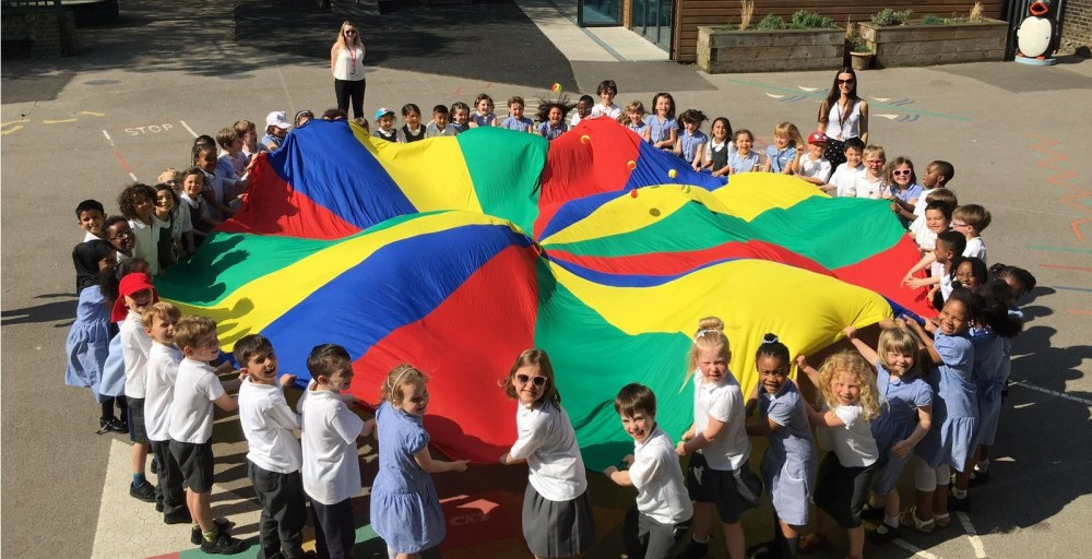 Ambler pupils boost physical skills by playing parachute games ...